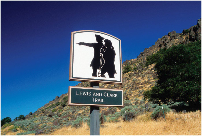 A sign marks a spot on the Lewis and Clark Trail in Oregon. The Lewis and Clark Expedition began in St. Louis, Missouri, and ended at the Pacific Coast near present-day Astoria, Oregon.