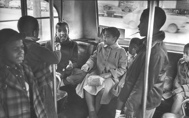 In March 1953, Linda Carol Brown (center) sits on a bus as she rides to her racially segregated elementary school in Topeka, Kansas. Eight-year-old Brown was the plaintiff in the celebrated Supreme Court case that declared racially segregated s