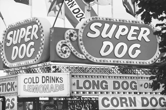 A garish hot dog stand at a county fair in Ohio.