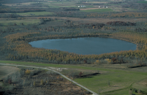 Kettle lakes like this one in Dundee, Wisconsin, are formed when blocks of ice buried by moving glaciers melt and leave a depression. (JLM Visuals.)