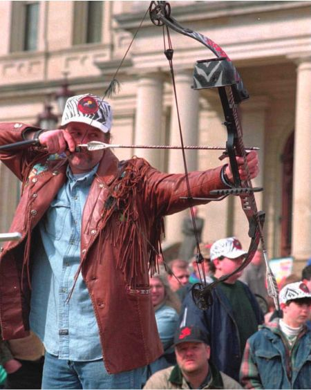 Pro-hunting activist and rock musician Ted Nugent displays his bow-hunting skills at the state capitol in Lansing, Michigan.