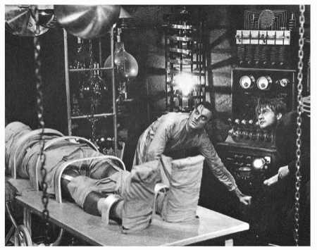The Monster (Boris Karloff) is brought to life by Dr. Frankenstein (Colin Clive) and his assistant Fritz (Dwight Frye) in the 1931 film adaptation of Frankenstein by Mary Shelley