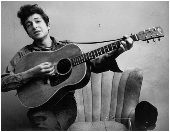 Singer and songwriter Bob Dylan brought complex lyrics and social relevance to the pop music scene with hits such as Blowin in the Wind in the early 1960s.