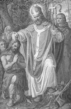St. Boniface baptizing a kneeling man. (Archive Photos)