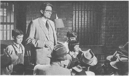 From the film To Kill a Mockingbird, starring Gregory Peck, Mary Badham, Phillip Alford, and John Megna, 1962.