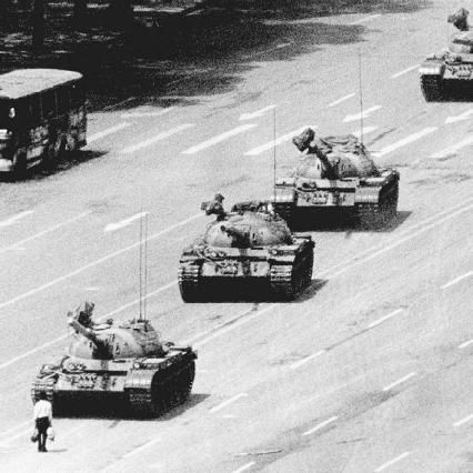 In the late 1940s, Orwell used many aspects of existing totalitarian and communist governments to construct the fictional government of Nineteen Eighty-Four. Pictured here are Chinese army tanks bearing down on a man during the Tiananmen Square