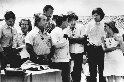 Cesar Chavez (center) and Dolores Huerta (far right) join other United Farmworkers Union board members at an event.