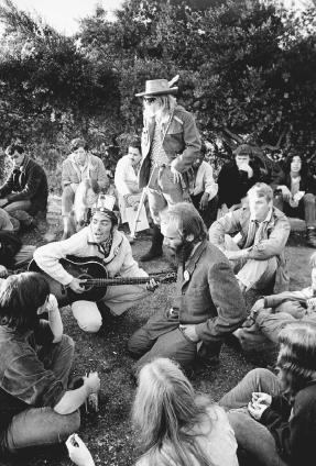 A group of hippies greets the sunrise with music from a hilltop in San Francisco, California, October 1967. AP/Wide World Photos. Reproduced by permission.