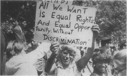 Women rally in support of the Equal Rights Amendment. The issue of equality is the central theme in Harrison Bergeron.