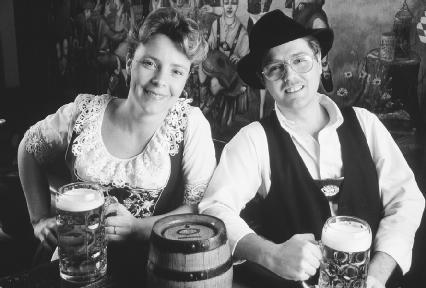 A couple in Sparta, New Jersey, drinking at Oktoberfest. Reproduced by permission of © Corbis.