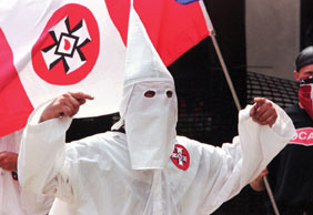 A member of the Ku Klux Klan at a rally held in Pennsylvania. Freedom of speech is guaranteed to groups that many people may find offensive. - AP IMAGES