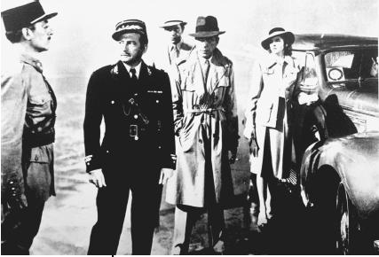 Claude Rains (in dark uniform), Humphrey Bogart (in trench coat), and Ingrid Bergman in a scene from the 1942 film Casablanca. (Reproduced by permission of AP/Wide World Photos)