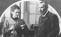 Marie and Pierre Curie in laboratory