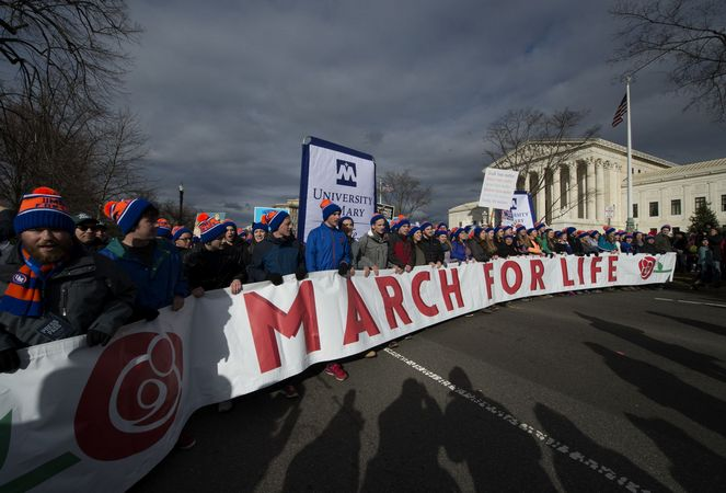 Participants Carry A Sign In The March For Life March