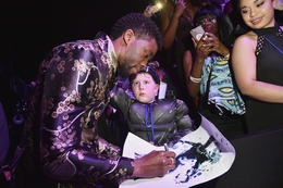 Actor Chadwick Boseman Signs Autographs at the Black Panther Premiere