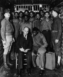 Attorney Samuel Leibowitz with the Scottsboro Boys in the Decatur, Alabama, jail.