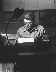 Poet Allen Ginsberg writes in his San Francisco home.
