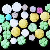 Ecstasy pills come in various shapes and sizes with symbols, words, and characters stamped on them....