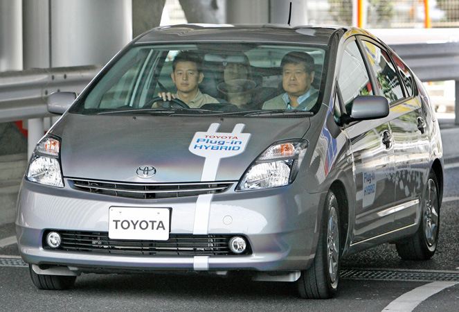 Hybrid Automobile in Japan, 2007. As automobile use continues to increase, along with knowledge of its detrimental effects on the environment, manufacturers are looking for ways to reduce negative impact. On a test course in Tokyo, individuals
