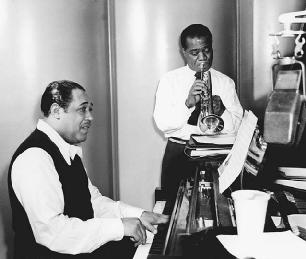Musicians Duke Ellington, left, and Louis Armstrong.