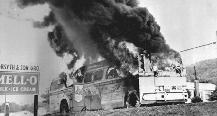 A Freedom Rider bus goes up in flames after a fire bomb was tossed through a window in 1961 in Alabama.