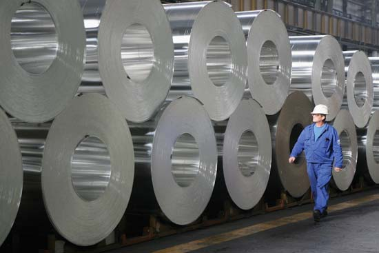 Rolls of processed aluminum sit in a factory in Hungary.
