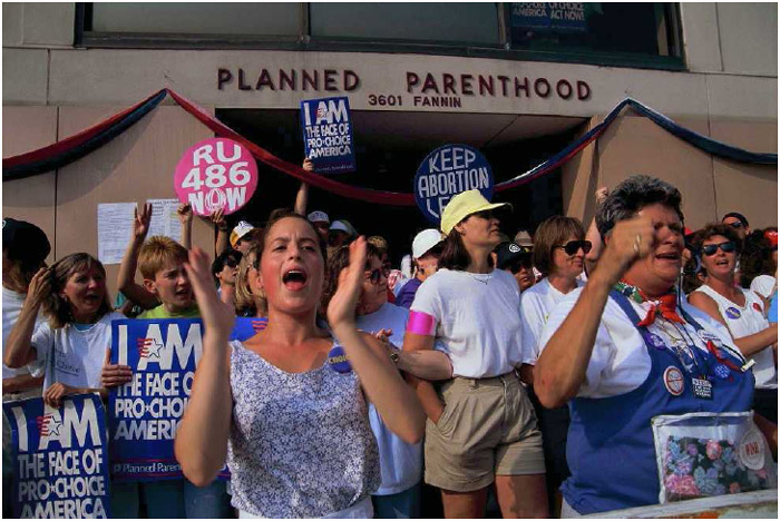 A pro-choice group demonstrates for abortion rights outside of a Planned Parenthood clinic in Houston, Texas, in 1992.