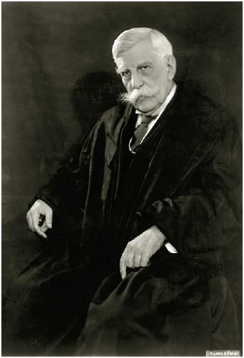 """Oliver Wendell Holmes Jr. (1841–1935), who served as an associate justice of the Supreme Court from 1902 to 1932 andformulated the famous """"clear-and-present-danger"""" test to determine the limits on the freedom of speech."""
