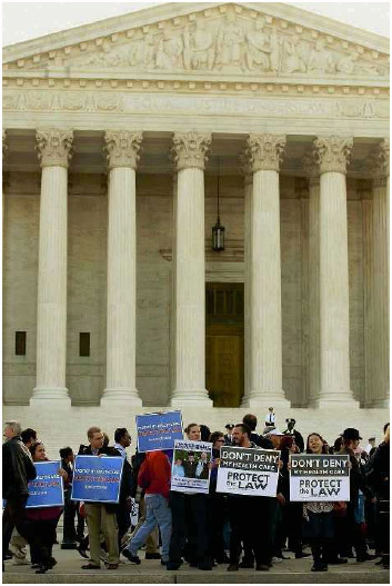 Supporters and opponents of healthcare reform demonstrating outside the Supreme Court while the justices heard arguments on the constitutionality of the Affordable Care Act, March 26, 2012.