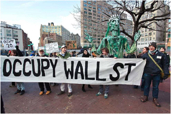 Occupy Wall Street protesters demonstrating against the influence ofmodern corporations and banks on the USgovernment, Manhattan, 2011.