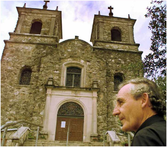 Father Tony Cummins outside of St. Peter the Apostle Church in Boerne, Texas, June 25, 1997.