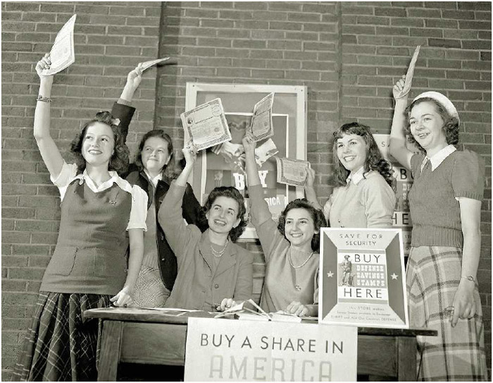 College students purchase stamps and bonds to help support the war effort, Columbia, Missouri, 1942.