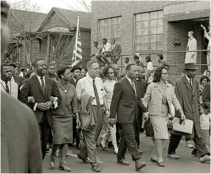 Martin Luther King Jr. (3rdfrom right) and his wife, Coretta Scott King, lead the historic fifty-four-mile civil rights march from Selma to Montgomery, Alabama, 1965.