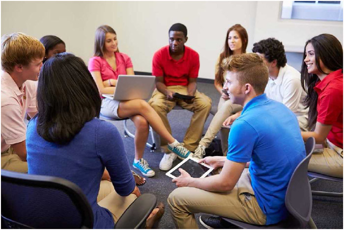 High school students taking part in a classroom discussion.