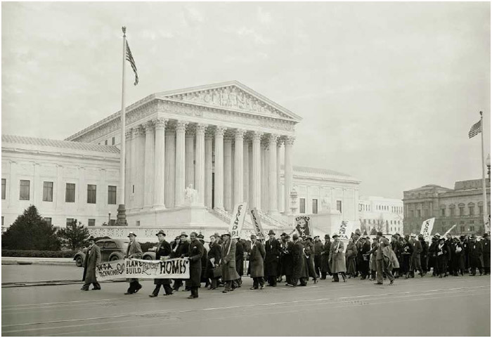 A citizens' march in Washington, DC, callingfor expansion of the Works Progress Administration, as it passes the Supreme Court, 1937.