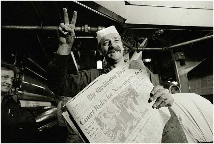 William Frazee, chief of the presses for the Washington Post, celebrates the Supreme Court ruling that allowed newspapers to continue publishing the Pentagon Papers, June 30, 1971.