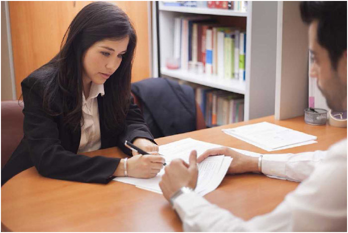 A businesswoman signing a contract.