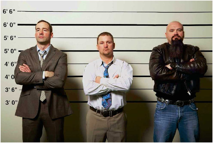 Three men stand in a police lineup, a procedure used to confirm the identity of a suspect.