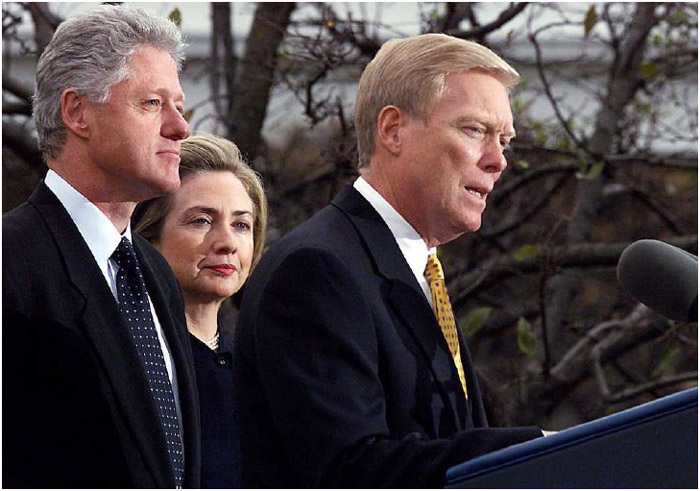 President Bill Clinton and First Lady Hillary Clinton listen as House Minority Leader Dick Gephardt makes remarks at a White House eventfollowing the House of Representatives' vote to impeach the president, December 19, 1998.