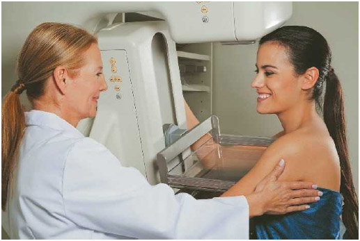 Patient being assisted by a technician during a mammography.