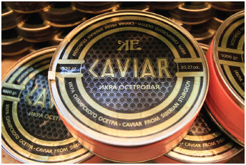 The manufacturer of this tin of expensive Russian caviar uses a variety of strategies to signify the value of the product to consumers, including attractive gold packaging (product), premium pricing (price), selective advertising (promotion), and