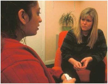 A therapist (on the right) in a counselling session with a patient.