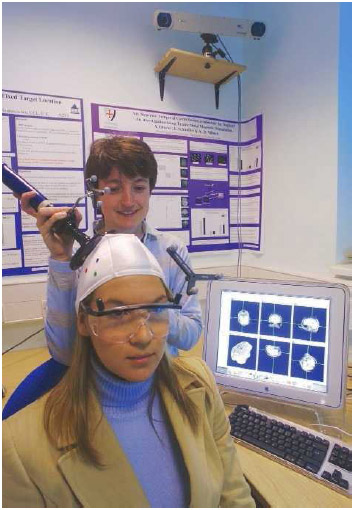 A woman undergoes transcranial magnetic stimulation (TMS).