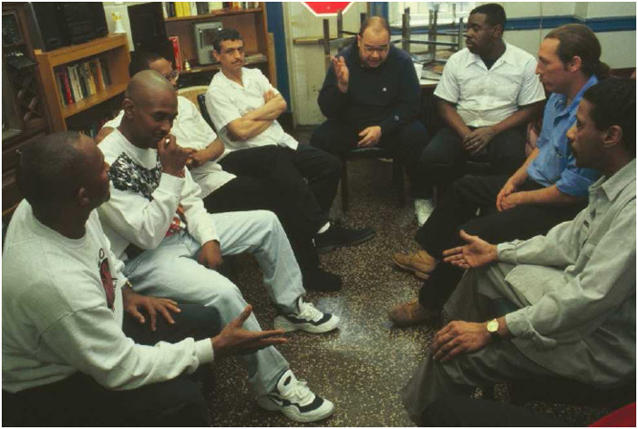 A group of men attend a substance abuse therapy session.