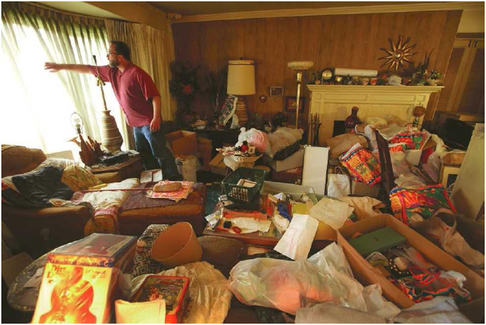 A man prepares to clean out the home of his recently deceased mother, who had hoarding disorder.
