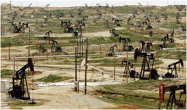 An oil field in Bakersfield, California. Oil is an unsustainable resource because use are using it faster than it could ever be replenished naturally.