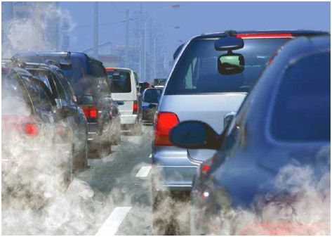 Clouds of exhaust surround cars in traffic. The combustible engines that power cars burn fuel as they run, creating emissions that cause air pollution.