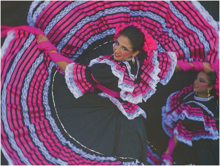 Dancers in traditional Mexican dress perform at the Cinco de Mayo Festival in San Diego, California.