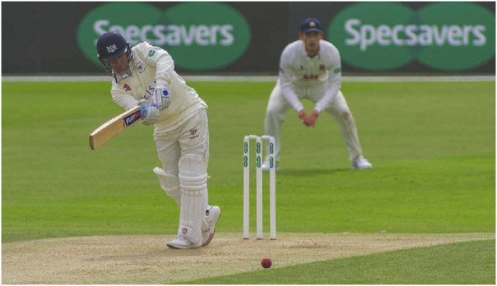 A Gloucestershire Cricket team member takes a swing during a match against Essex on Day 1 of the Specsavers County Championship in Chelmsford, England, April 2016.