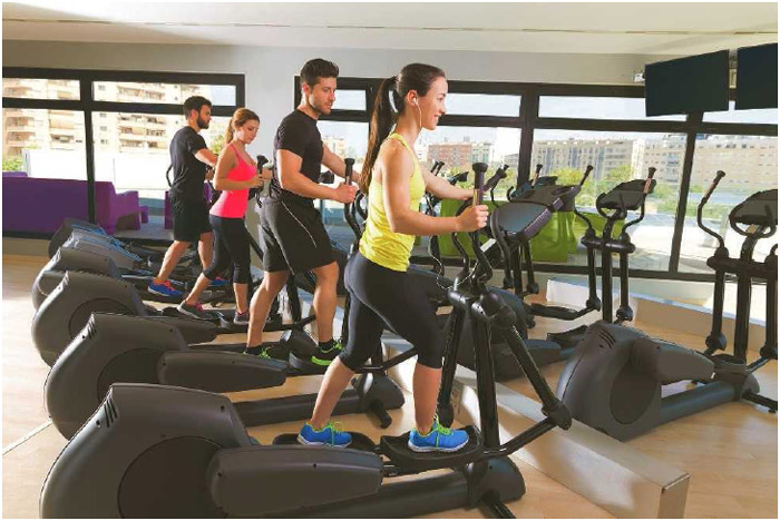 Elliptical trainer exercise machines, such as those pictured here, allow for cardiovascular exercise while putting less strain on the joints than activities like running or cycling.
